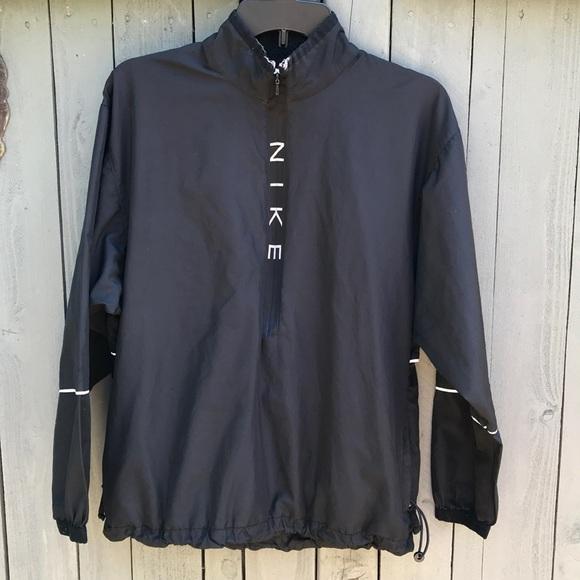 Vintage Nike Black Pullover Half Zip Track Jacket.  M 5b13293d3c984482bea89ec5 4478b28e4